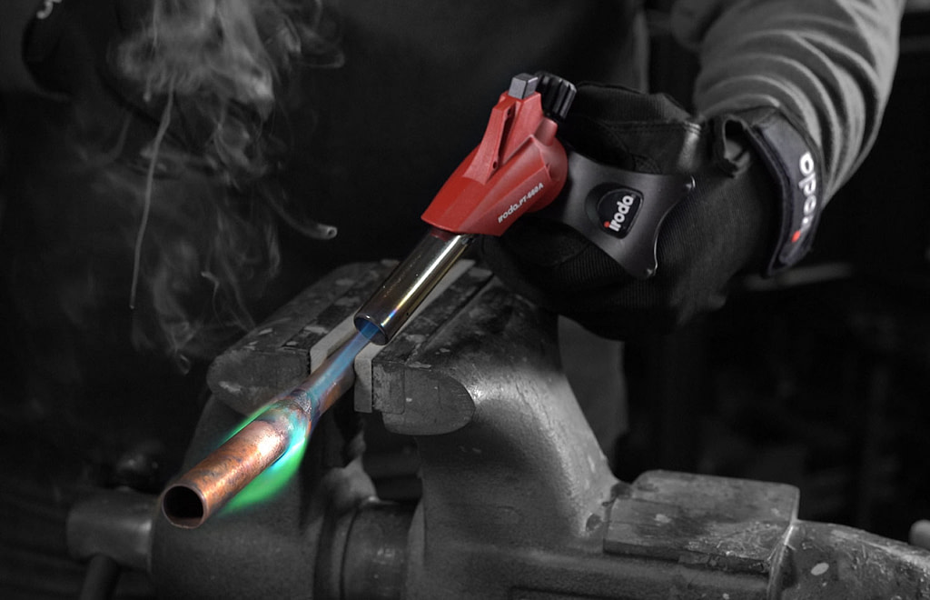 A Person is doing soldering by using Pro-Iroda's PT-660A Butane Cartridge Torch