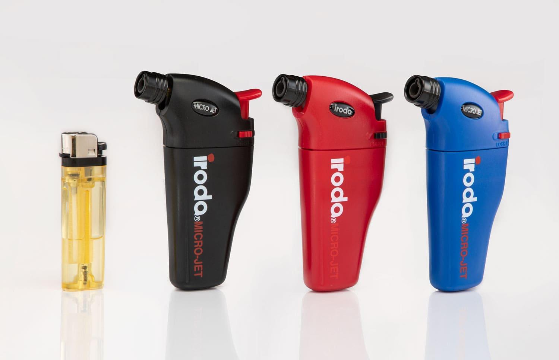 Three Pro-Iroda's MJ Series Precision Butane Jet Lighters and a lighter
