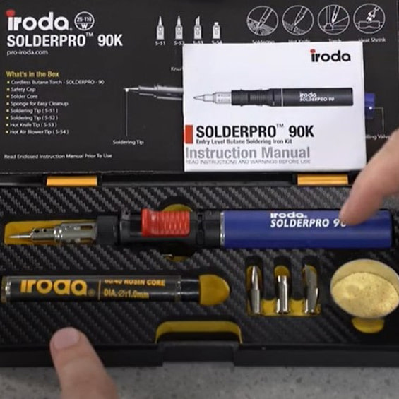 A Person Pointing at SOLDERPRO 90K Professional Butane Soldering Iron Kit